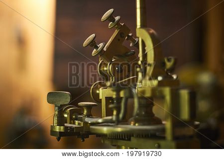 Antique device for precision working on jewelery