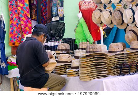 OAXACA MEXICO MARCH 4: Man sells hats and clothes on the street in Oaxaca Mexico on March 4 2017
