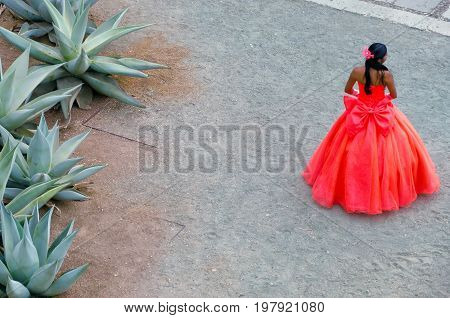 Girl with colorful dress in the main plaza in Oaxaca Mexico
