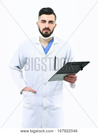 Man With Concentrated Face In White Coat. Dentist In Mask