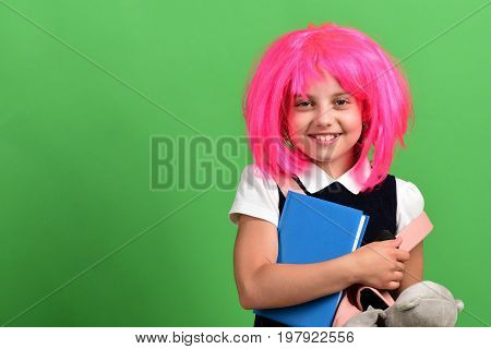 Back To School And Education Concept. Girl Holds Blue Book