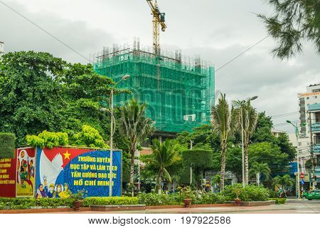 View of Nha Trang city construction with socialist poster, September, 2016, Vietnam