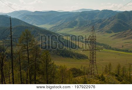 Electric pillar in the mountain, sunny day