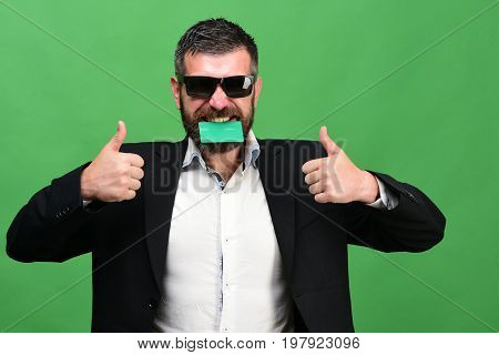 Guy With Happy Face And Sunglasses Isolated On Green Background