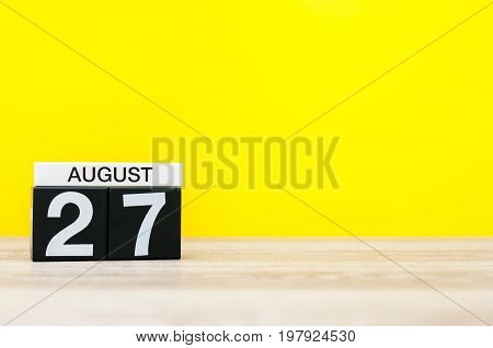 August 27th. Image of august 27, calendar on yellow background with empty space for text. Summer time.