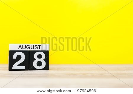 August 28th. Image of august 28, calendar on yellow background with empty space for text. Summer time.