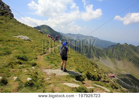 Mountaineering - man walking in the mountains