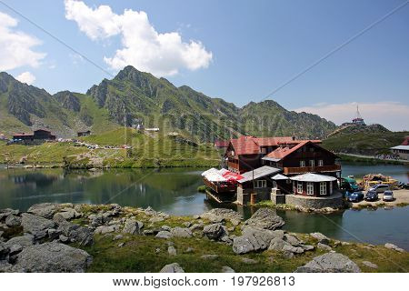 Mountain hut near Balea lake during sunny day in Fagaras Mountains, Romania