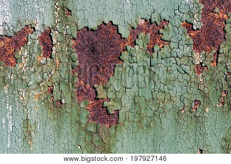 Rusty metal surface with cracked green paint abstract rusty metal texture rusty metal background for design with copy space corrosion