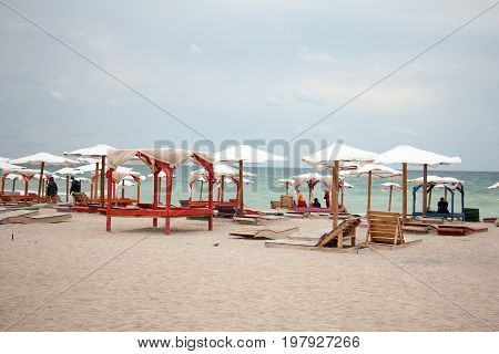 Sun umbrellas at an exotic beach with blue water