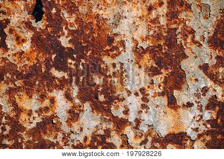 texture of rusty iron cracked paint on an old metallic surface sheet of rusty metal with cracked and flaky paint corrosion decay metal background decay steel decay