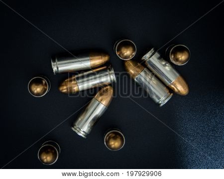 9mm silver bullet for a gun on drak background.Bullet isolated