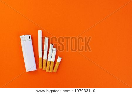 Quit smoking concept, orange background top view