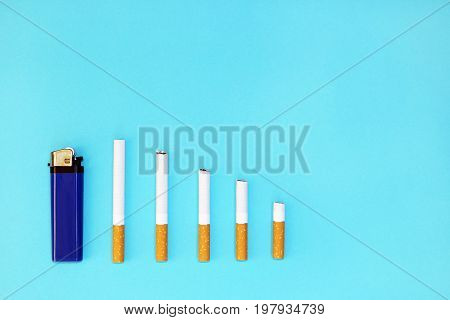 Quit smoking concept ,cigarettes on blue background