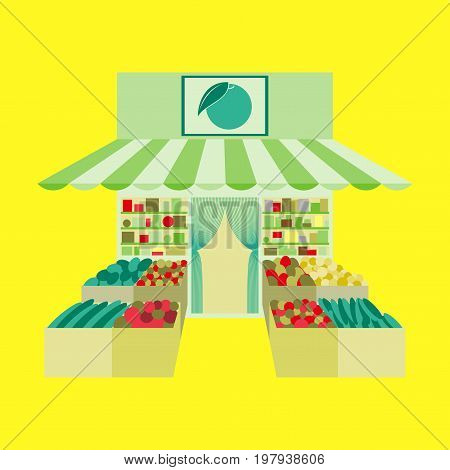 Local fruit and vegetables store building. Groceries crates in front of storefront