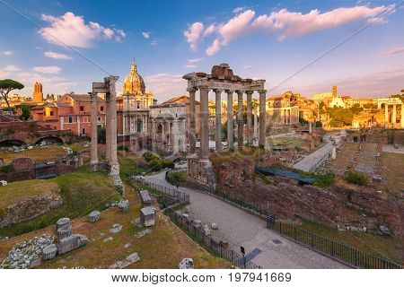 Ancient ruins of a Roman Forum or Foro Romano at sunset in Rome, Italy. View from Capitoline Hill