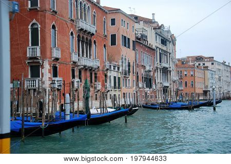 Scene in Venice Italy, with gondolas and channel.