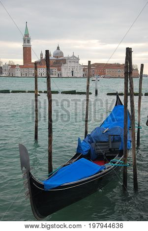 Scene in Venice Italy, with a blue gondola