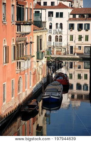 Scene in Venice Italy, with boats anr channel