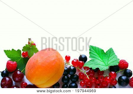 Ripe red currant black currant raspberries and cherry on a white background. Berries on the border of the image with a copy of the space for text.