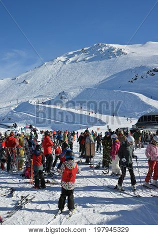 Mount Hutt New Zealand - July 30 2017: Mount Hutt Ski Field at Lunch Time. Skiers prepare to ride on the Chairlift outside the restaurant Canterbury New Zealand.