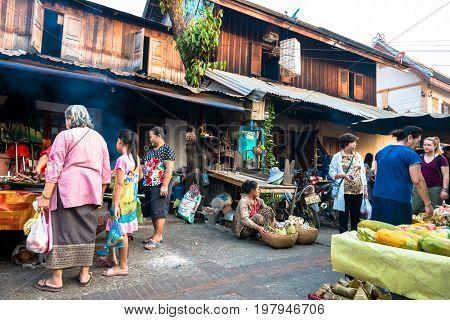 LUANG PRABANG LAOS - MARCH 12 2017: Lao people shopping at Luang Prabang's Morning Market Laos.