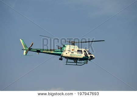 MIAMI - MARCH 27: Miami Dade County police helicopter departs on patrol over the city on March 27 2017 from its home base Opa Locka Airport