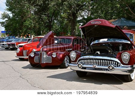 CASSELTON, NORTH DAKOTA, July 27, 2017: The annual Casselton Car Show which occurs the last Thursday of July features classic vehicles such as the restored 1953 Buick Roadmaster with an open h0od.