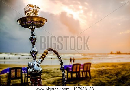 hookah shisha smoke on beach background .