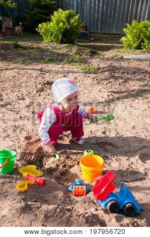 Child Of Year And Half Plays In Sandbox
