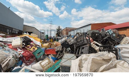 dump industrial waste - Heaps of plastic debris . Against the blue sky, heaps of plastic debris lie
