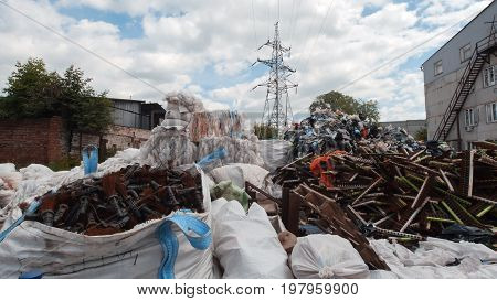 Industrial waste - Heaps of plastic debris . Against the blue sky, heaps of plastic debris lie