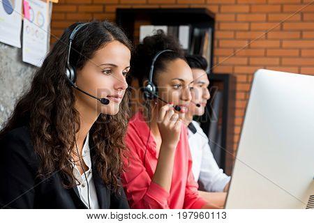 Multiethnic telemarketing customer service agent team call center job concept