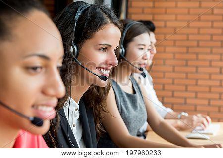 Smiling multiethnic telemarketing customer service agent team call center job concept