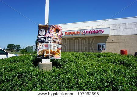 SOUTH HOLLAND, ILLINOIS / UNITED STATES - MAY 22, 2017: Dunkin' Donuts offers a drive-thru service at the Illinois Tollway's Chicago Southland Lincoln Oasis.