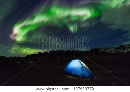 Camping in the north with the northern lights overhead Aurora Borealis