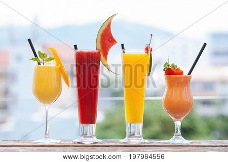 Set of healthy smoothies made of tomato, orange, watermelon, mango. Fruit and vegetable juices