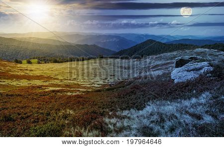 day and night time change concept image. huge stones among the grass on top of the hillside meadow near the edge of a mountain. vivid summer landscape.