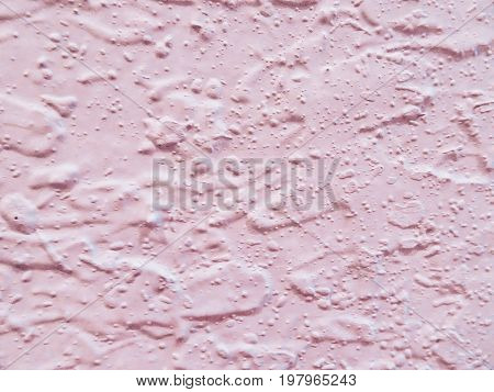 pastel pink speckled, bumpy wall texture background