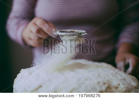 Close Up View Of Baker Kneading Dough. Homemade Bread. Hands Preparing Bread Dough On Wooden Table.