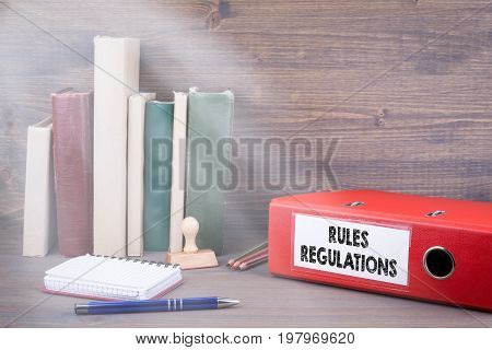 Rules And Regulations. Binder on desk in the office. Business background.