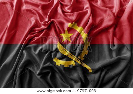 Ruffled waving Angola flag national background close