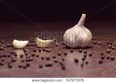 garlic. fresh garlic. cloves of garlic and black pepper ingredients for thai food on wooden table background