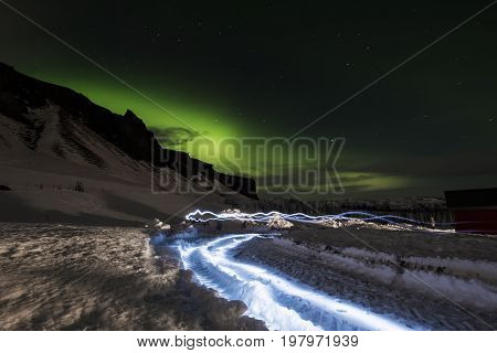 Aurora Borealis in with light effects, in winter at Iceland