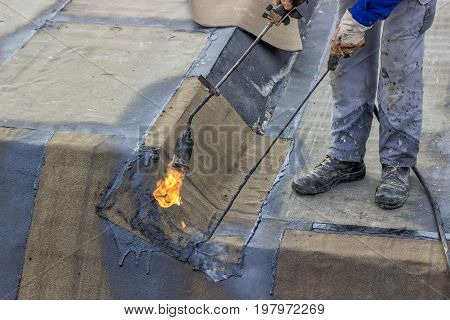 Insulation Worker And Propane Blowtorch 2