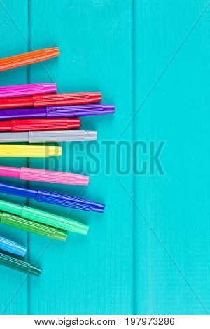 Colorful marker pen set on blue background