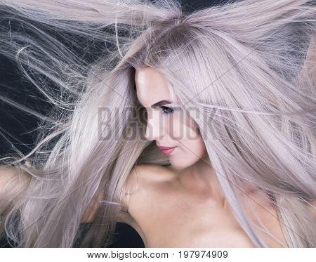 Flying long blonde grey hair portrait shot