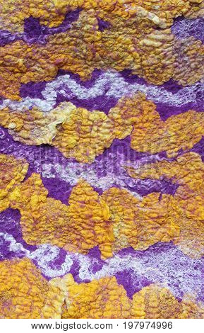 Texture of yellow purple and white wallow fabric
