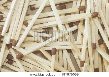 Background of wooden matches with brown heads