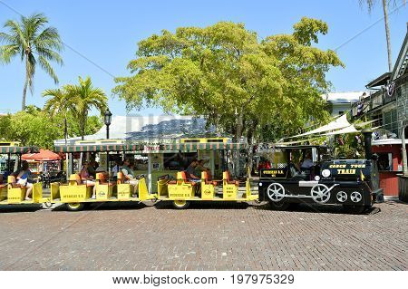 Key West Florida Keys Florida USA - May 15 2017 : Key West Conch Tour Train taking tourists around the tourist attractions